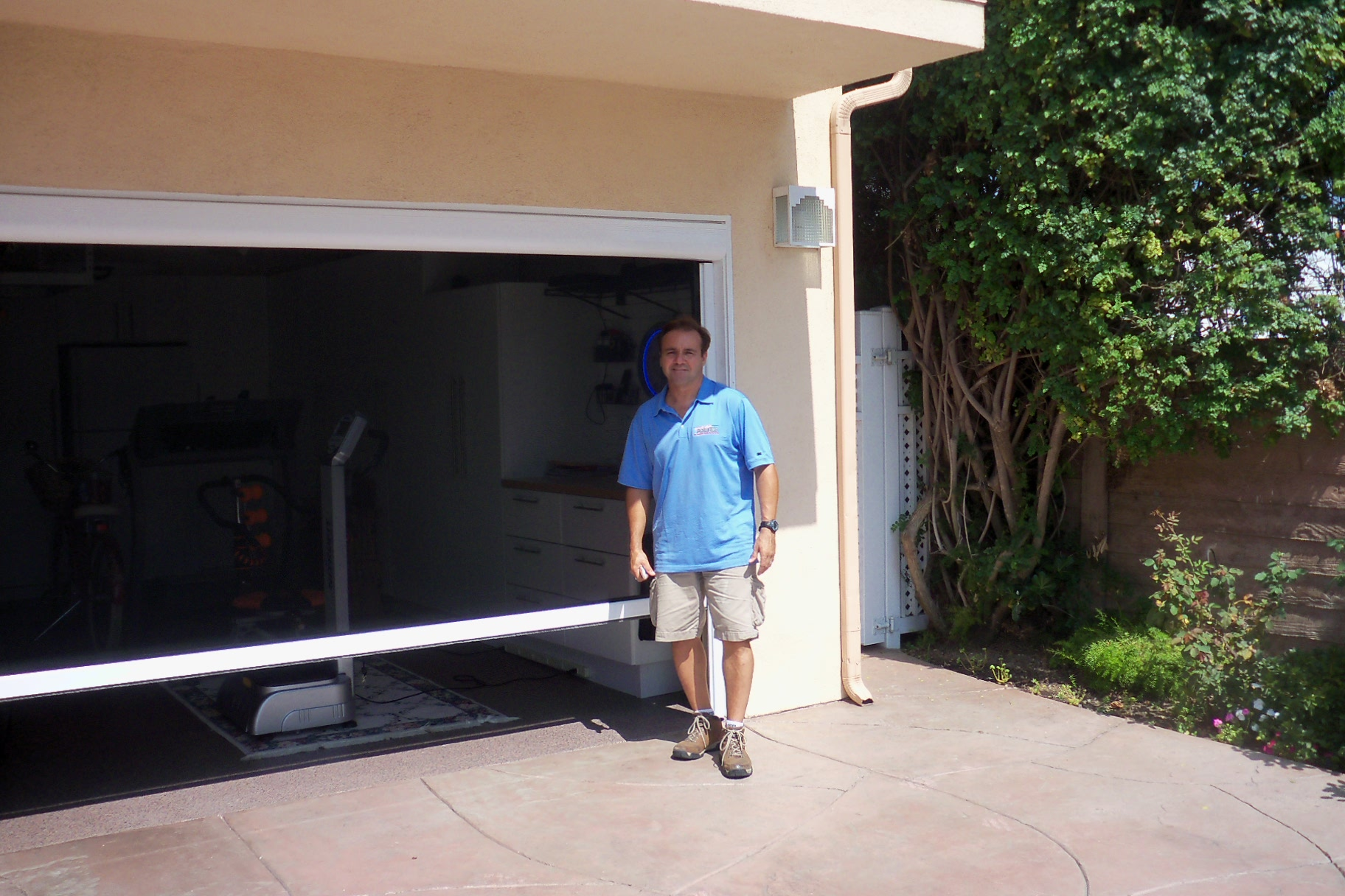 Motorized door central florida garage screens for Motorized garage door screens