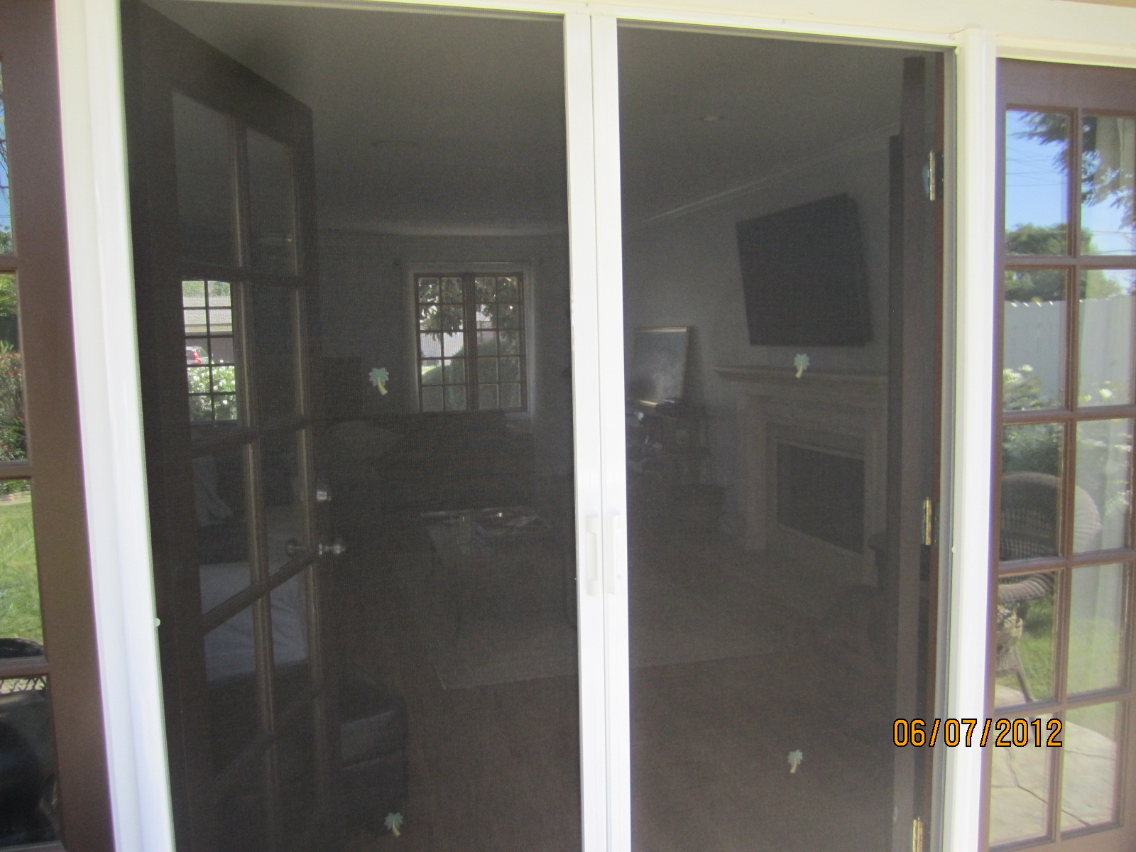 Double set of retractable screen doors in sherman oaks for Double door screen door