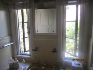 Beverly Hills Retractable Screen Windows in Bathroom