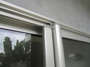 Encino installation of Clear Anodized Retractable Screen Door for a patio sliding screen door