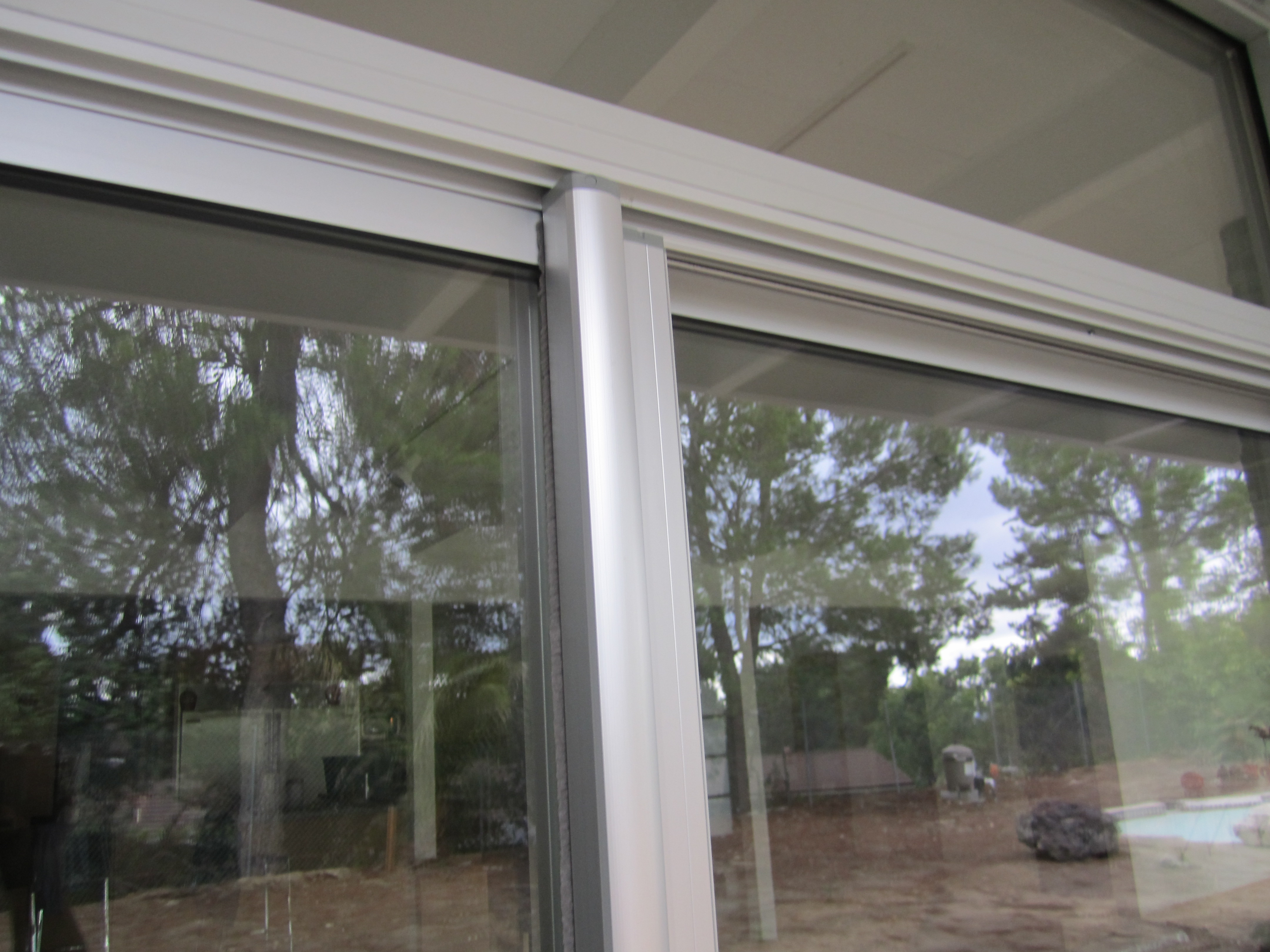 Clear Anodized Retractable Screen Door for a patio sliding screen