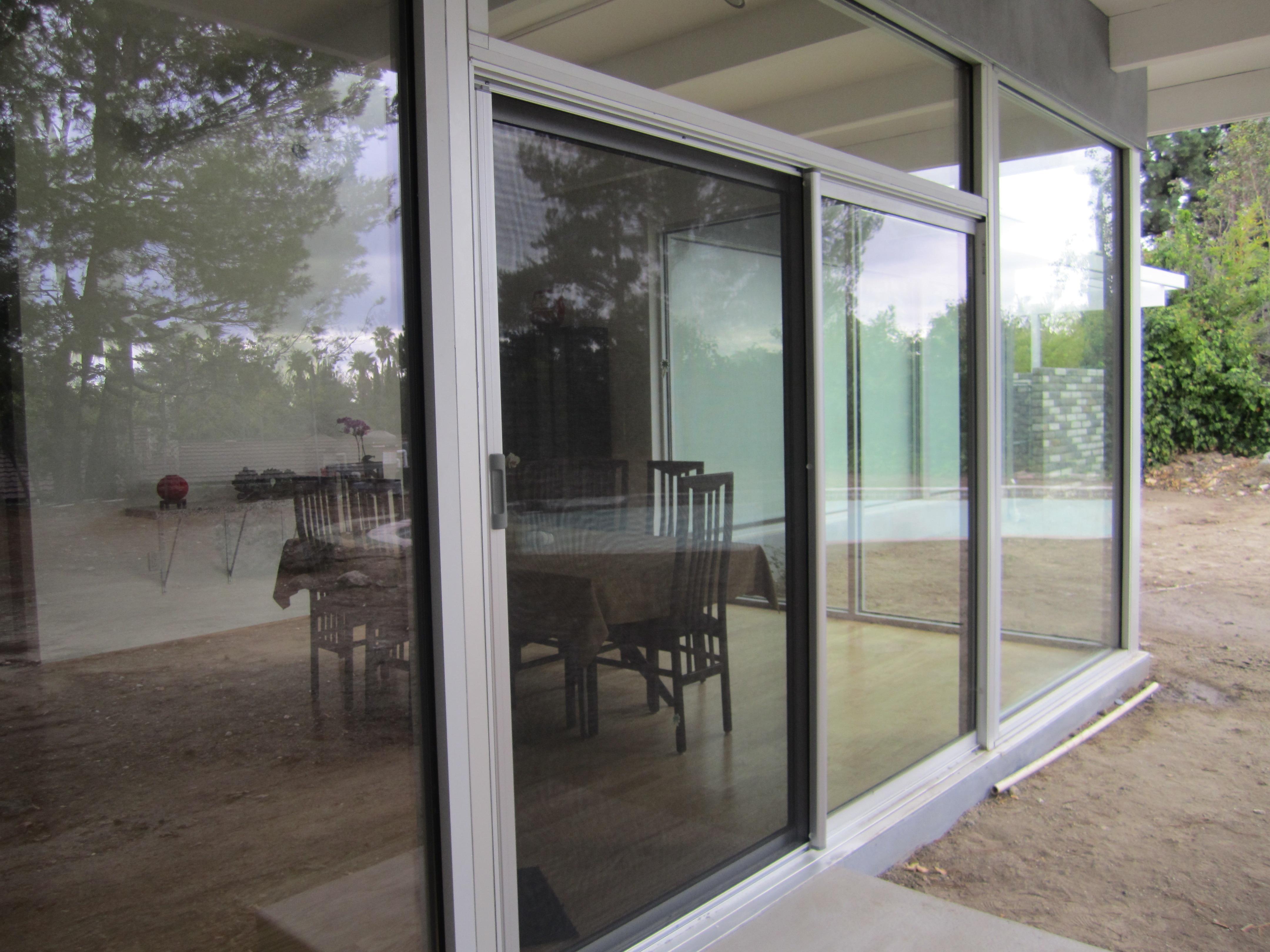Clear Anodized Retractable Screen Door for a sliding screen door
