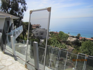 White Extruded Aluminum Sliding Patio Screen Doors Fabricated Custom Made and ready to be installed in Malibu Oceanview Home