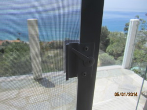 View from Living Room of Sliding Patio Screen Door Extruded Aluminum White Handle installed in Malibu Oceanview Home