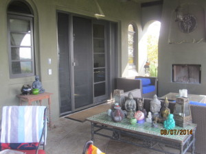 After view installation of custom made heavy duty sliding screen doors and sidelight panels with pet screen on double french doors in Topanga