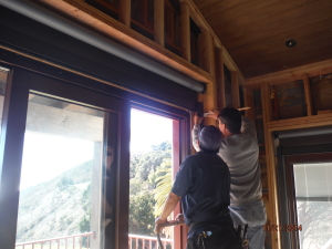 Installation Motorized Power Screens front view bi-folding windows in Santa Barbara in 2nd floor