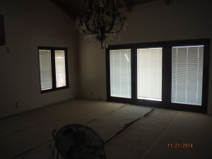 Custom painted and made Mahogany brown/brick retractable screen doors installed on double set sliding wood doors