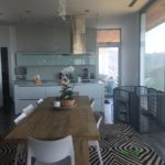Kitchen installation of Anodized Silver Hinged Screen Door in Malibu Mountains