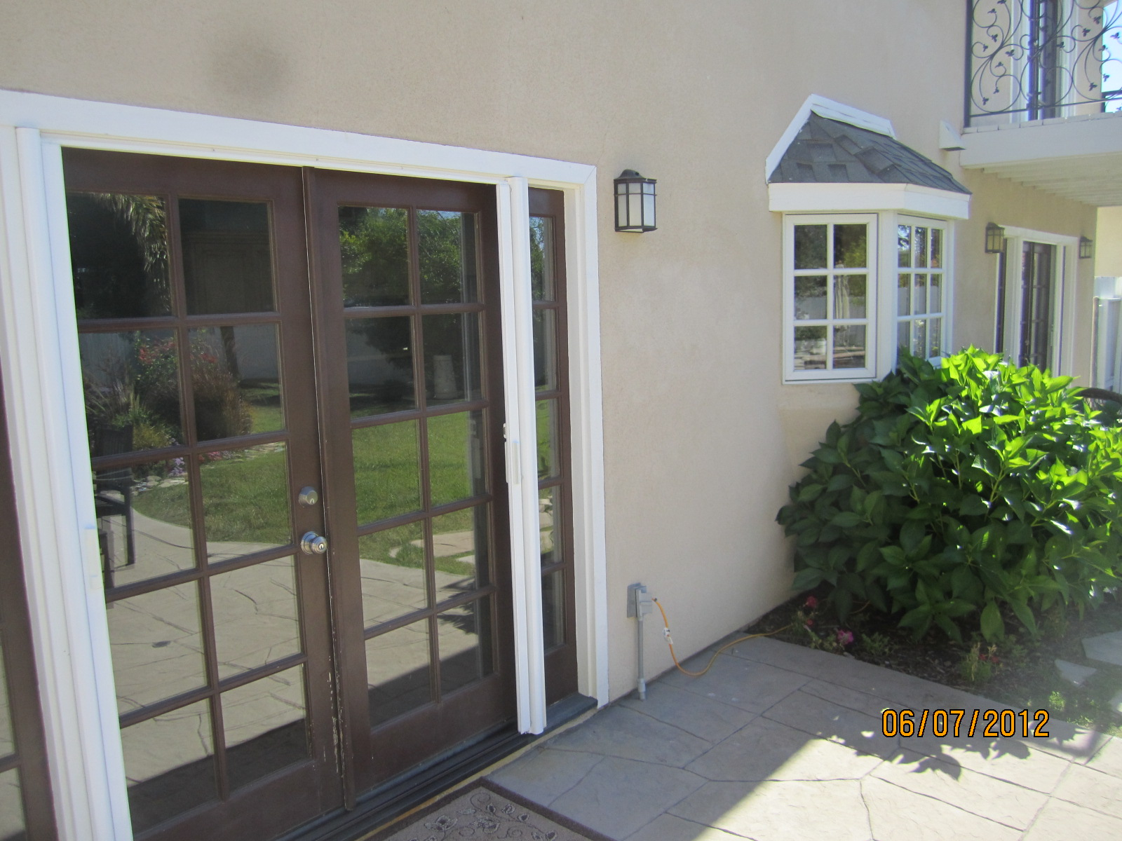 Exterior View Retracted French Doors Of Retractable Screen Doors