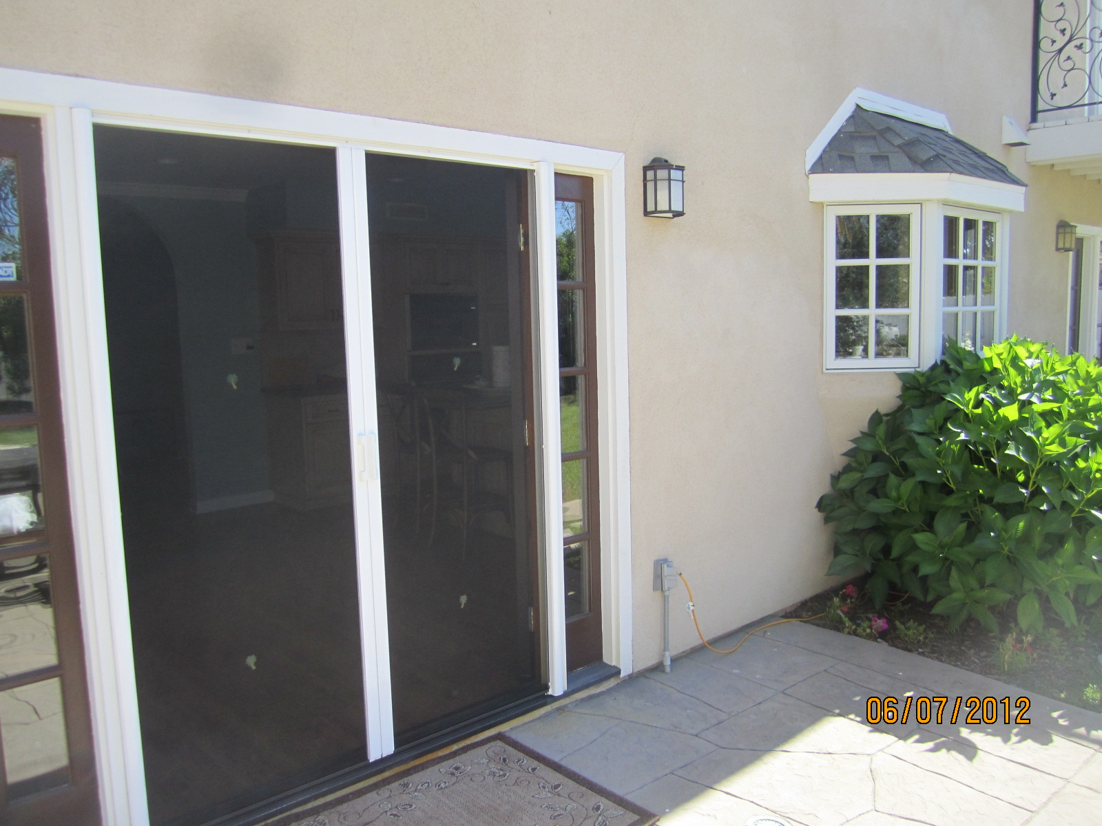 Exterior View French Doors of Retractable Screen