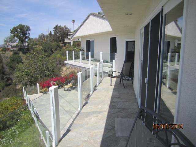 View From Master Bedroom Of White Extruded Aluminum Sliding Patio